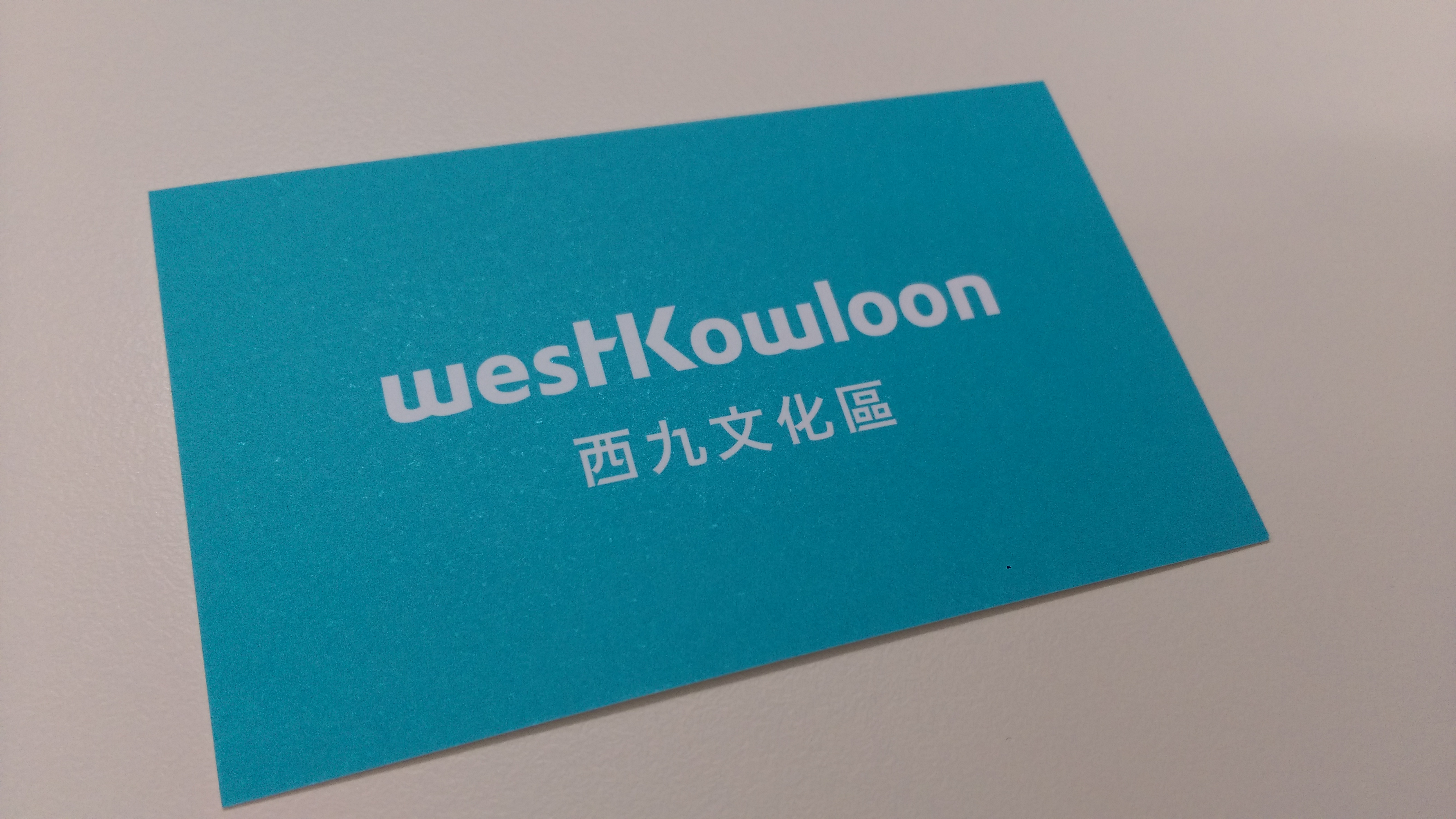 The eye-catching blue color name card shows WKCDA's dynamic character.